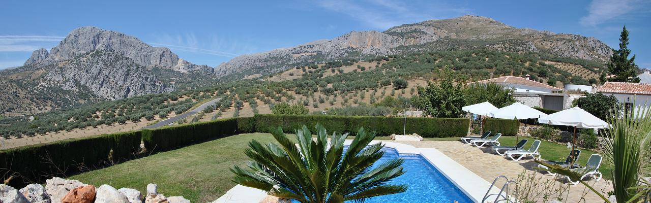 Our six lovely apartments for 1-3 persons in a restored Andalusian farmhouse with views to the Viñuela lake