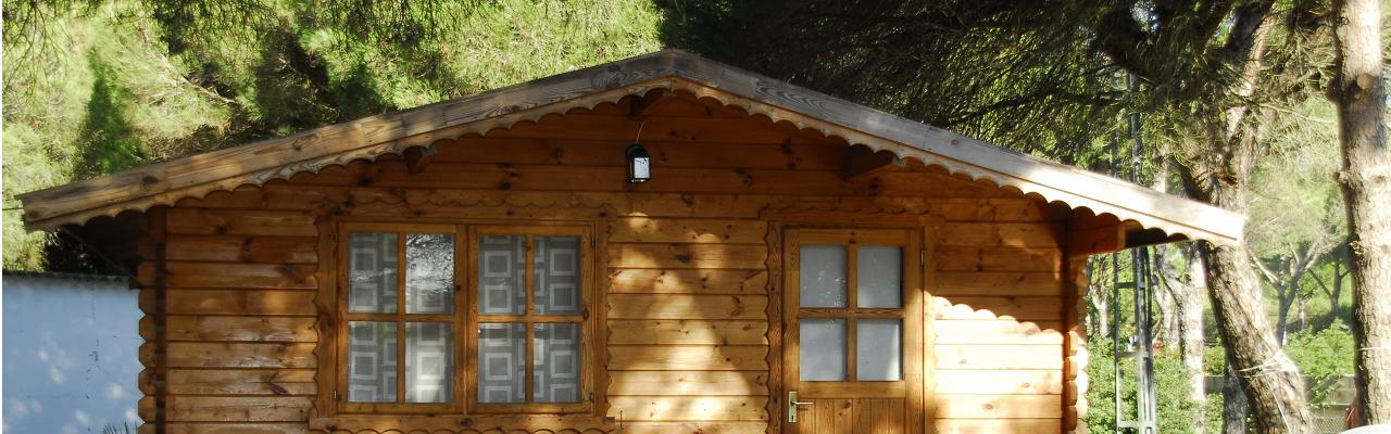 Our cosy log cabins under the trees - near one of the best beaches of Conil de la Frontera