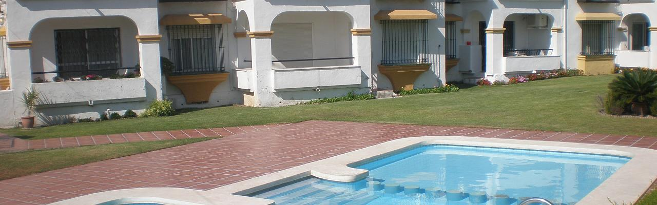 Our fine apartment on the ground floor of a small cosy complex with terrace right out to the green pool area