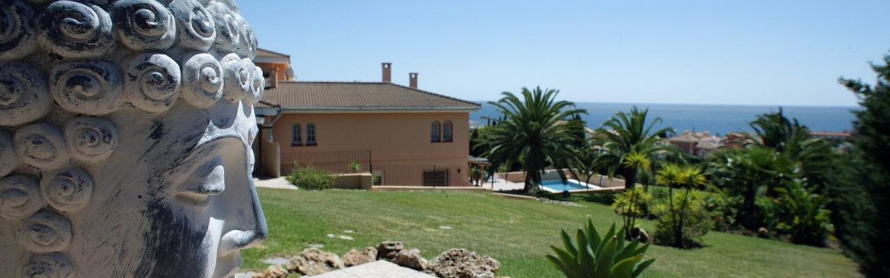 Our very special apartment with it's own fountain in the patio - in a great villa with pool and sea views